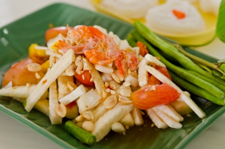 Somtam , Coconut shoot salad with shirmp ,bean and vegetable  photo