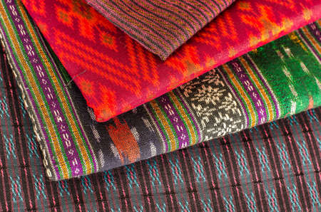 Stack of Thai style fabric at shop photo