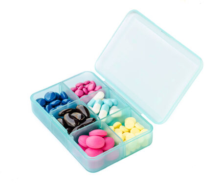 therapie:  Tablet dispenser with many medicine pills