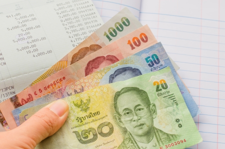 Thai banknotes on bookbank and account book background