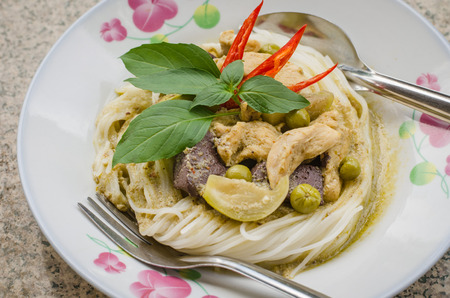 Green curry with rice noodles ,Thai traditional cuisine photo