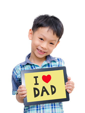 Beautiful funny Asian boy holding a tablet computer with love Dad message on screen photo