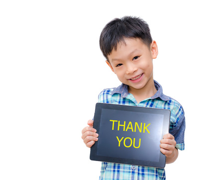 Beautiful funny Asian boy holding a tablet computer with thank you message on photo