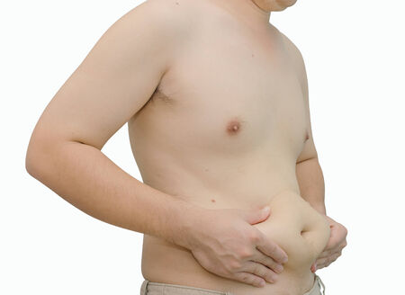 breast pocket: Asian man showing his belly on white background