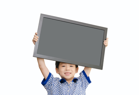 Little Asian boy holding chalkboard  over white background  photo