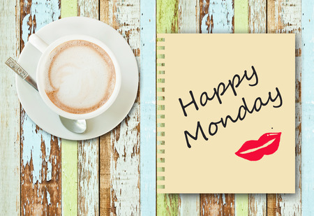 Coffee cup on old wood background with message  Happy Monday