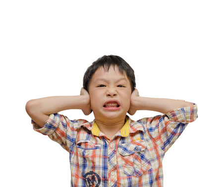 disobedient child: Displeased Boy covering his Ears from the Noise  Isolated on white background  Stock Photo