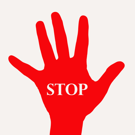 Red hand with word stop on white background  photo