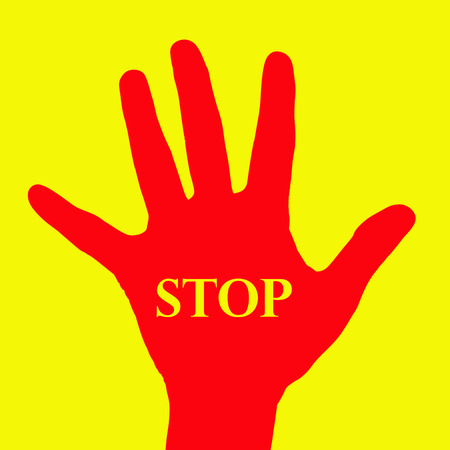 red hand: Red hand with word stop on yellow background