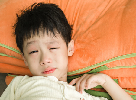 Sick Asian boy crying Stock Photo