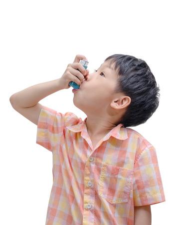 Asian boy using bronco dilator medicine on white background photo