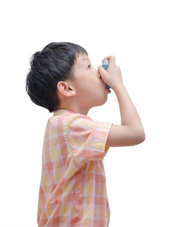 Asian boy using bronco dilator medicine on white background