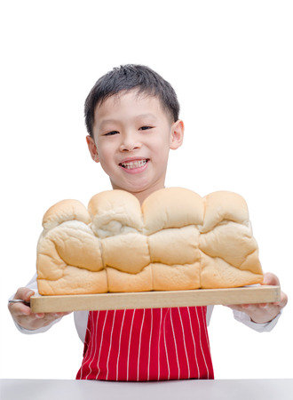 Little Asian cook with bread isolated on white background