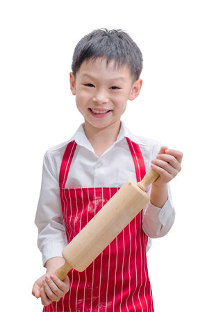 Smiling little cook with rolling pin isolated on white background  Reklamní fotografie