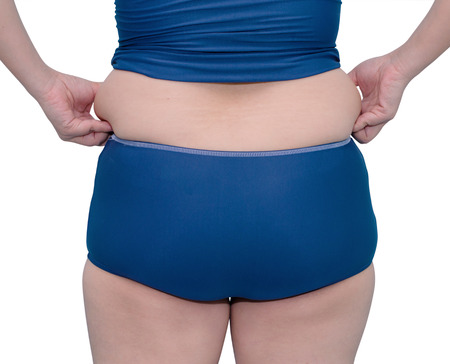 Fat woman s back in swim suit on white background  photo