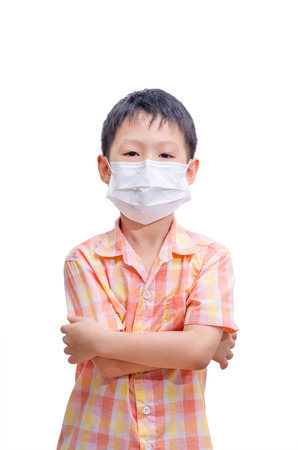 Asian boy in medicine healthcare mask isolated on white  Standard-Bild