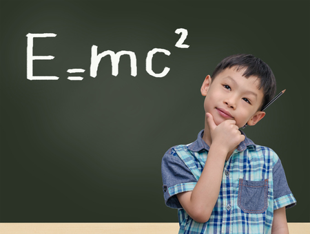 mc2: Student by chalkboard with e=mc2  Stock Photo