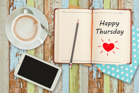thursday: Happy Thursday on notebook with smart phone and coffee cup