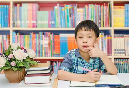 stumped: Asian student doing his homework