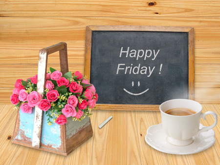 Happy Friday on chalkboard with coffee cup photo