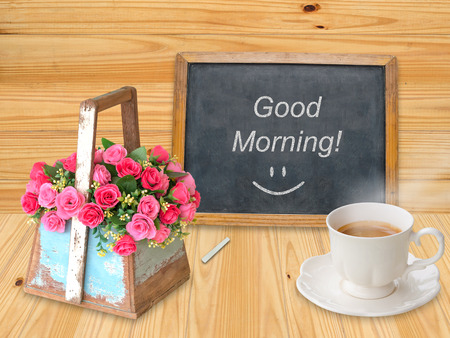 Good morning on chalkboard with coffee cup photo