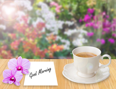 coffee in the garden terrace with Good morning on paper note photo