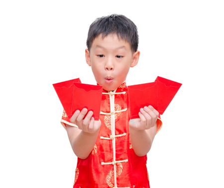 Asian boy in traditional Chinese dress with red envelopes on white background,Chinese new year concept. photo