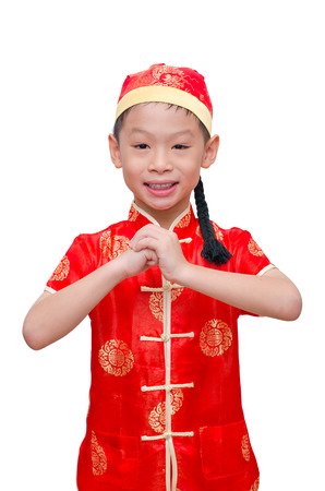 Asian boy in traditional Chinese dress on white background,Chinese new year concept. photo