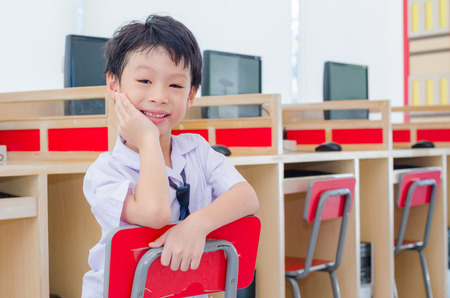 Happy Asian student in computer room photo