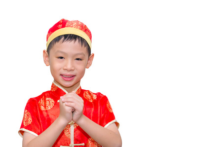 Happy Chinese new year.Young Asian boy with gesture of congratulation on white background photo