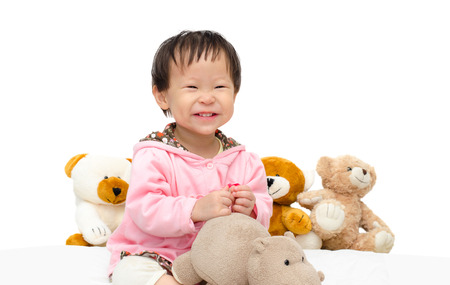 Happy Asian girl playing with bear and hippo toy photo