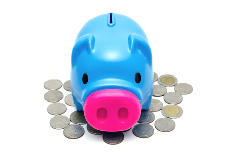 Blue piggy bank or money box and coins on white background. photo