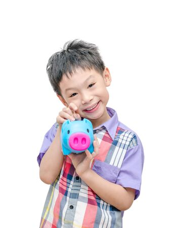 Asian smiling boy with piggy bank isolated on white photo