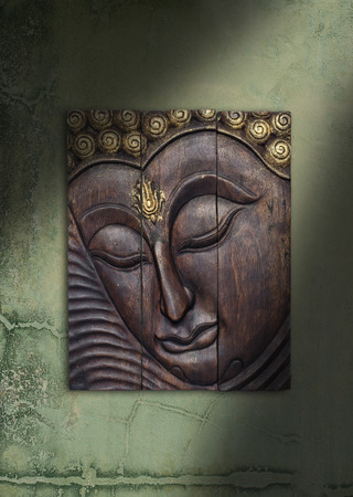 thai style: Buddha image in Thai style wood graving on the wall Stock Photo