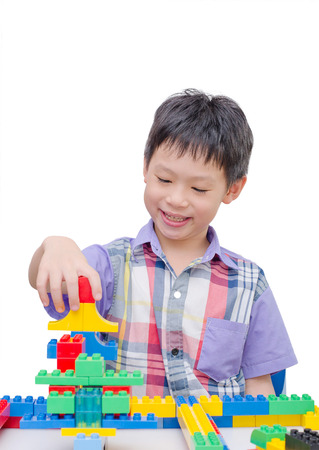 building blocks: Happy Asian boy playing with building blocks