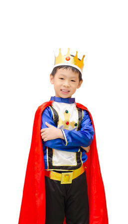 Asian boy is dressed in suit of a prince standing over white background