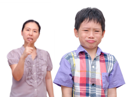 naughty woman: Young Asian Boy Being Scolded by his mother