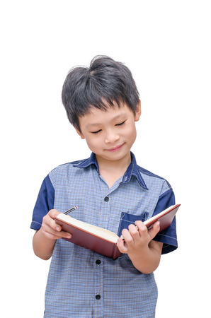 Happy Asian boy reading a book over white background Standard-Bild