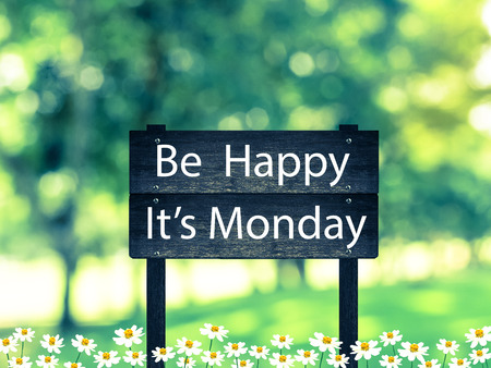 Be Happy ,Its Monday signpost in beautiful woodland with vintage filter