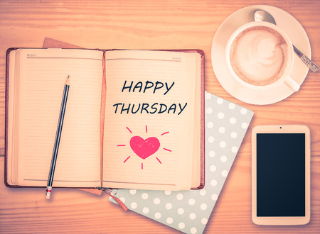 thursday: Happy Thursday on notebook , pencil, smart phone and coffee cup with vintage filter Stock Photo