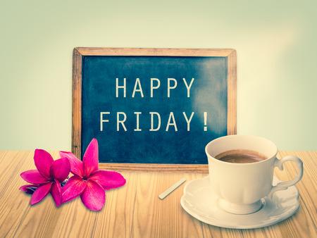 Happy Friday on chalkboard with vintage filter Standard-Bild