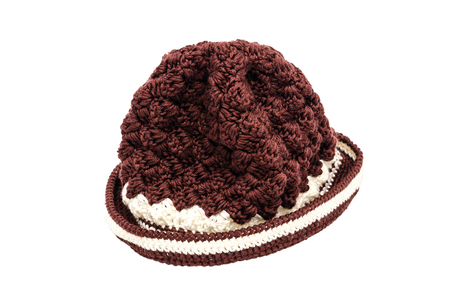 knitten: Brown knitted wool hat isolated on white background
