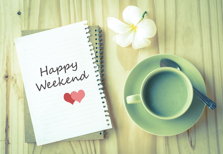 Happy Weekend on paper and green tea cup with vintage filter Stock Photo