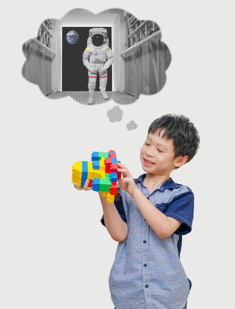 Asian boy playing blocks and dream to be astronaut Stock Photo
