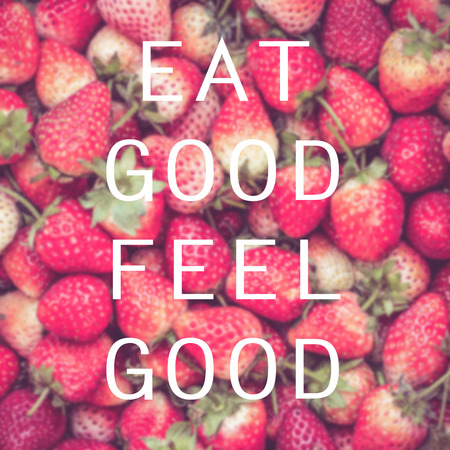 by feel: Good quote on strawberry background , Eat good feel good Stock Photo