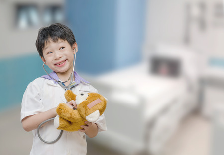 pretend: Asian child pretend to be doctor in hospital