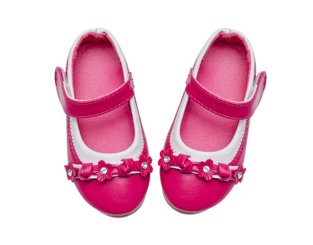 Pink child shoes isolated over white background