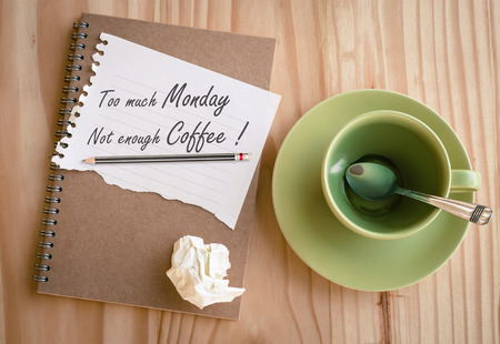 enough: Notebook with quote : Too much Monday not enough coffee Stock Photo