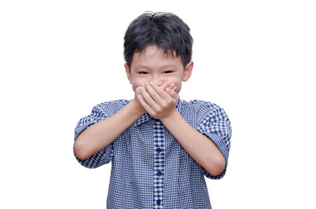 Asian boy close his mouth by hands over white