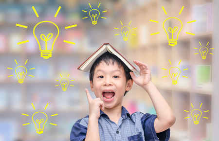 kid book: Young Asian student thinking with light bulbs in library